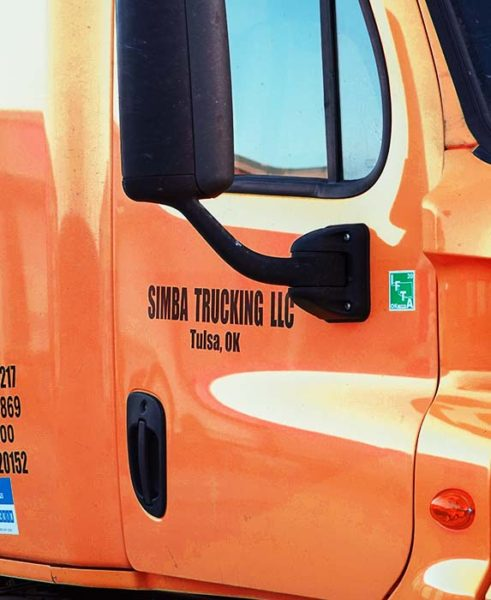 Simba Shippers LLC orange semi truck